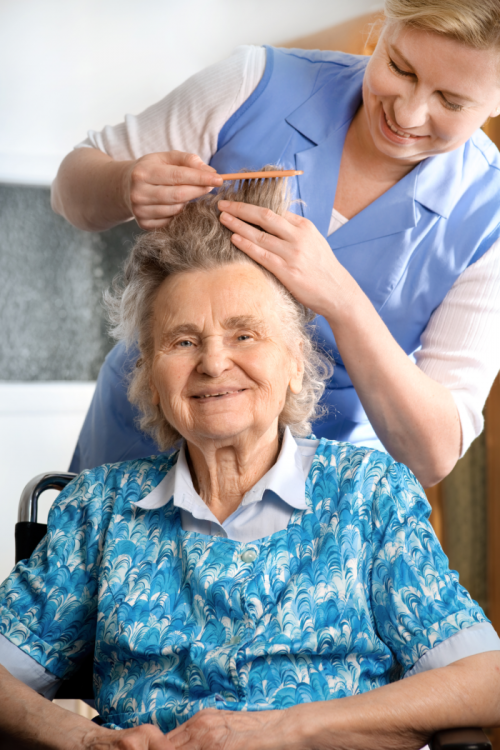 nurse combing elders hair