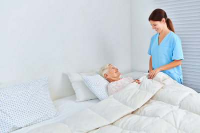 caregiver smiling to the old woman