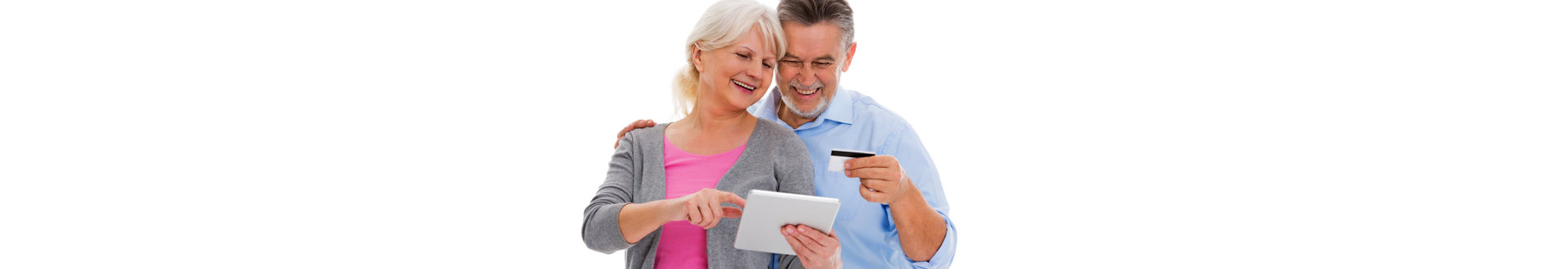 elderly couple smiling while holding a credit card